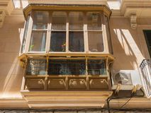 Palma de Mallorca, Spain. The typical balconies on the facades of the buildings and houses in the old city center. Summer time Stock Image