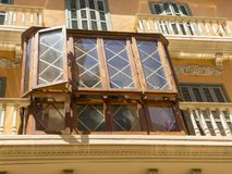 Palma de Mallorca, Spain. The typical balconies on the facades of the buildings and houses in the old city center. Summer time Stock Photo