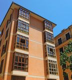 Palma de Mallorca, Spain. The typical balconies on the facades of the buildings and houses in the old city center. Summer time Stock Photos