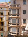 Palma de Mallorca, Spain. The typical balconies on the facades of the buildings and houses in the old city center. Summer time Royalty Free Stock Image