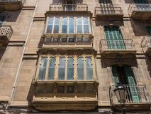 Palma de Mallorca, Spain. The typical balconies on the facades of the buildings and houses in the old city center. Summer time Royalty Free Stock Photography