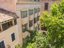 Palma de Mallorca, Spain. The typical balconies on the facades of the buildings and houses in the old city center. Summer time Royalty Free Stock Images