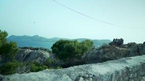 Palma de Mallorca Spanien, klippor, växter, spansk flora, staket, gå för ultrarapid lager videofilmer