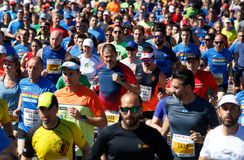Palma half marathon running race runners detail. Runners compete during the Palma half marathon running race in the Spanish island of Mallorca stock photos