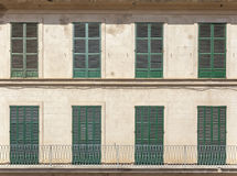 Palma Mallorca,Balearic Islands,Spain. Architecture detail, symmetrical facade green windows and balconies with blinds closed in Palma de Mallorca, Balearic Royalty Free Stock Image