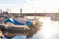Boats in Portixol marina during the sunset. PALMA, SPAIN - DECEMBER 6, 2017: Boats in Portixol marina during the sunset Royalty Free Stock Images