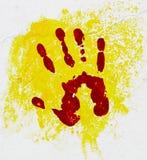 Palma vermelha no fundo amarelo. Imagem de Stock Royalty Free