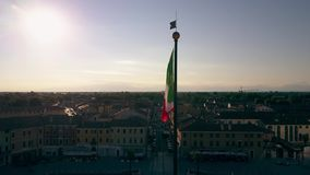 PALMANOVA, ITALY - AUGUST 9, 2017. Aerial view of waving Italian flag in the central square of the town. PALMANOVA, ITALY - AUGUST 9, 2017. Aerial view of waving stock video footage