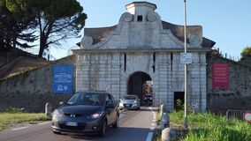 PALMANOVA, ITALY - AUGUST 11, 2017. Car road to the ancient town gate Stock Image