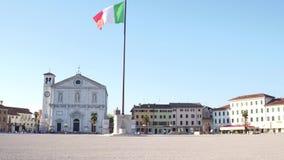 PALMANOVA, ITALY - AUGUST 11, 2017. Central city square and waving Italian flag Royalty Free Stock Photos