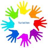 Palmas de manos coloreadas unidas Foto de archivo