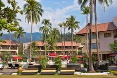 Palmas tropicales del hotel c Fotografía de archivo libre de regalías