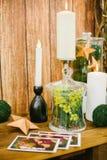 Palmatoria con la vela y mimosa en florero Imágenes de archivo libres de regalías