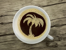 Palme in coffee cup Royalty Free Stock Photos