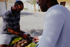 ocal villager man playing Ouril game at the main square during the afternoon stock images
