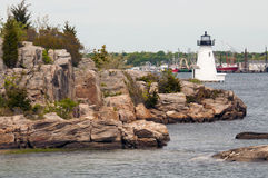 Palmer Island Harbor Lighthouse in Masachusetts. Palmer Island lighthouse was built to guide mariners in New Bedford Harbor along the rocky coast in Royalty Free Stock Photo