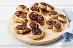 Palmierkoekjes - Franse die koekjes van bladerdeeg en chocol worden gemaakt Royalty-vrije Stock Foto's
