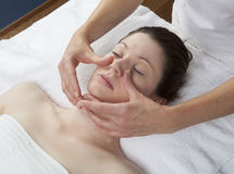 Palming massage at the beauty salon. Physical therapist practicing a facial massage Royalty Free Stock Images
