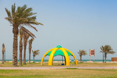 Palms and arbor on the coast of Persian Gulf. RAHIMA, SAUDI ARABIA - MAY 10, 2014: Palms and arbor on the coast of Persian Gulf Stock Photography