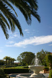Palms and Fountain. A California fountain with palm fronds framing the photo Stock Photos