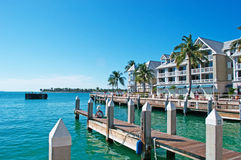 Palms, houses, pier, Key West, Keys, Cayo Hueso, Monroe County, island, Florida. Key West, Keys, Cayo Hueso, State of Florida, Sunshine State, coast, Gulf of Royalty Free Stock Photos