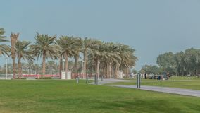 Palms in the MIA Park timelapse, located on one end of the seven kilometers long Corniche in the Qatari capital, Doha. Green grass and path Stock Images