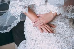 Palms of the newly-married couple with wedding rings.  Royalty Free Stock Images