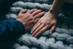 Palms of the newly-married couple with wedding rings.  Royalty Free Stock Photography