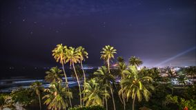 Palms Night Zoom Clouds View Timelapse 4k. Timelapse of some palm trees during the night with the ocean in the background in Sri Lanka. 4k footage stock footage