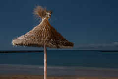 Palms parasol on empty beach on night time Stock Photography
