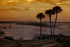 Palms Silhouetted at Castillo de San Marcos royalty free stock photos