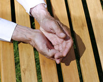 The palms of wrinkled hands of an elderly man Stock Photo
