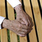 The palms of wrinkled hands of an elderly man Royalty Free Stock Photography