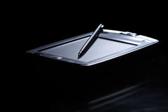 Palmtop in back light. Black background. Palmtop in back light with reflection. Black background Stock Photos