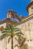 Palmtree and blue tiled dome at the Plaza del Carmen in Valencia. Spain Stock Photos