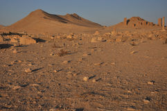 Palmyra and desert. Though the ancient site fell into disuse after the 16th century, it is still known as Tadmor in Arabic. Palmyra is completely in middle of Stock Photography