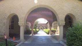 Stanford Gate Palo Alto. Palo Alto, California, United States - August 13, 2018: Gate to Main Quad at Stanford University Campus, one of the most prestigious stock video footage