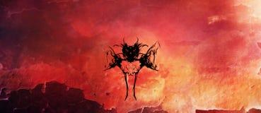 Palo como la criatura silueteada contra las llamas Fotografía de archivo