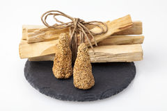 Palo Santo incense. Bursera graveolens, known in Spanish as Palo Santo `holy wood` is a wild tree from Latin America. It is used for crafting objects and to Royalty Free Stock Photography