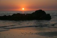 Palolem beach goa4. Sunset in Goa India with rock Royalty Free Stock Photos