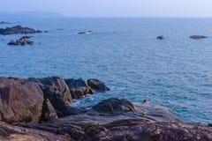 Palolem beach on sunset. Rocky coast in Goa, India Stock Photos