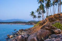 Palolem beach on sunset. Rocky coast in Goa, India Stock Images