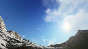 Palomas que vuelan, montañas nevosas