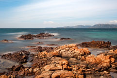 Palombaggia beach, Corsica. Long exposure picture of sea water passing through rocks on the beach of Palombaggia, in the south of Corsica Royalty Free Stock Photos