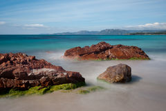 Palombaggia, Corsica. Long exposure of sea water passing through rocks on the beach of Palombaggia, in the south of Corsica Royalty Free Stock Photography