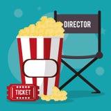 Palomitas de maíz y boleto de la silla del director del cine Foto de archivo libre de regalías
