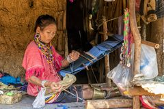 Palong Hill Tribe Woman, Northern Thailand. Woman from Palong tribe with traditional clothes, working on a loom, Chiang Rai, Thailand, Asian stock image
