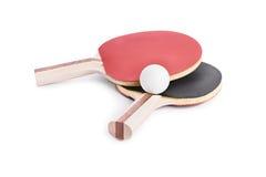 Palos de Ping Pong con una bola Imágenes de archivo libres de regalías