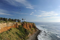 Palos Verdes California Lighthouse. A coastal California lighthouse protects the point at Palos Verde Peninsula, California. Catalina Island can be seen in the stock photos