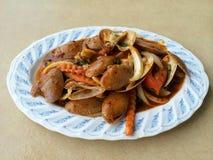 Palourdes frites par émoi avec la pâte rôtie de piment Photos stock